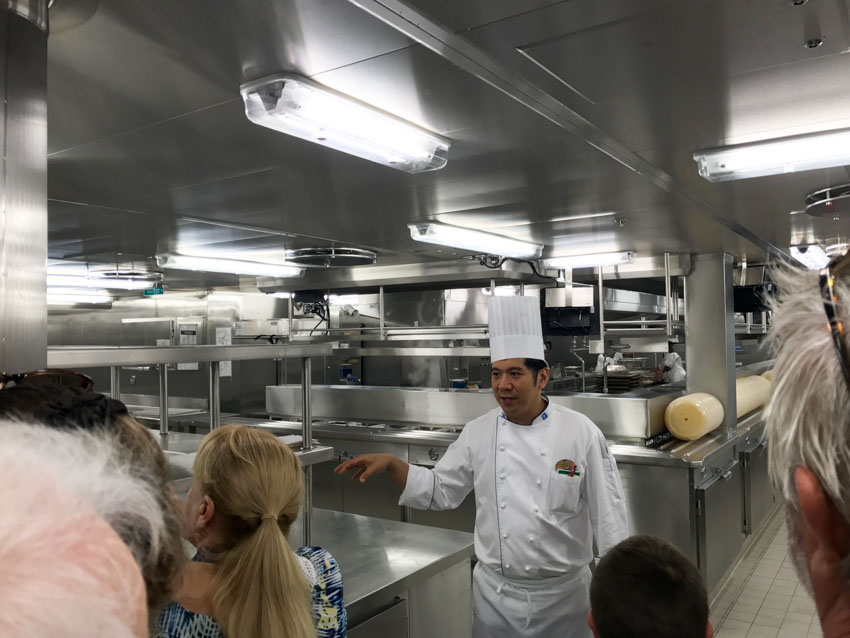 The chef telling us about the duties of the kitchen crew