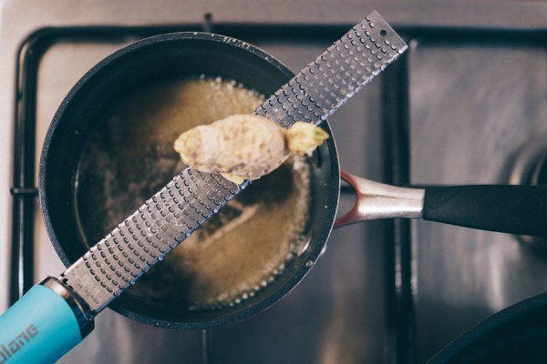 Grate ginger for syrup