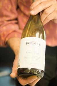 Stephen Skelton at Billingsgate Market Seafood School, holding Bolney Estate Pinot Gris 2013