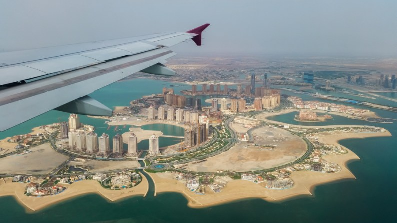 Flying into Doha with Skyline of Pearl Qatar