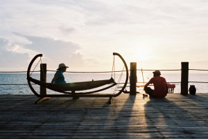 Woman sitting on hammock at Zanzi Resort, talking to man, Zanzibar | @dipyourtoesin