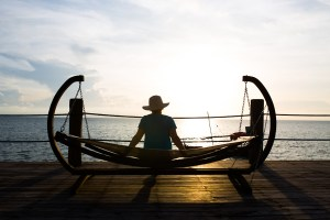 Woman sitting on hammock at Zanzi Resort, Zanzibar | @dipyourtoesin