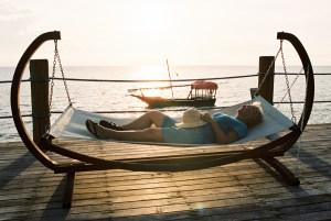 Woman sleeping on hammock at Zanzi Resort, Zanzibar | @dipyourtoesin