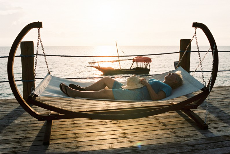 Woman sleeping on hammock at Zanzi Resort, Zanzibar | @dipyourtoesin