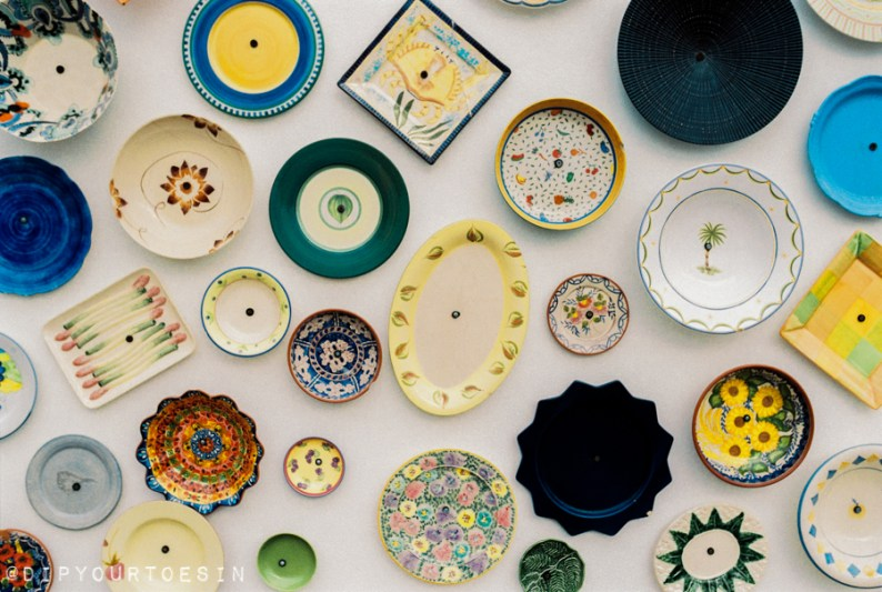 Traditional Portuguese pottery at artisan workshop with plates on wall, Cape St. Vincent