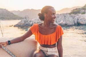 Black woman lounges onboard a gulet yacht in SW Turkey