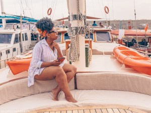 Black woman lounges onboard a gulet yacht in SW Turkey