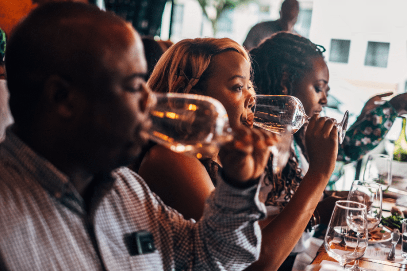 A wine tasting event hosted by Cha McCoy