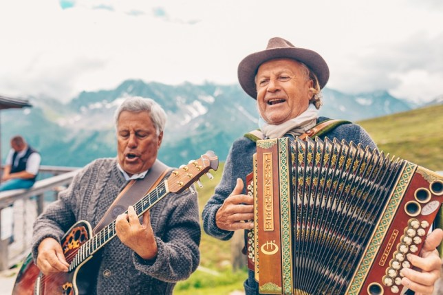 Traditional alpine performers at Culinary Jakobsweg