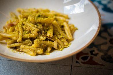 Nebrodi ribbon pasta sits in a white pasta bowl