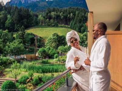 Couple on balcony in Bio-Hotel Rupertus | wellness in Saalfelden Leogang
