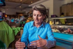 Speaking with Eva Rainer in Dorfladen organic food cafe in Leogang, Austria