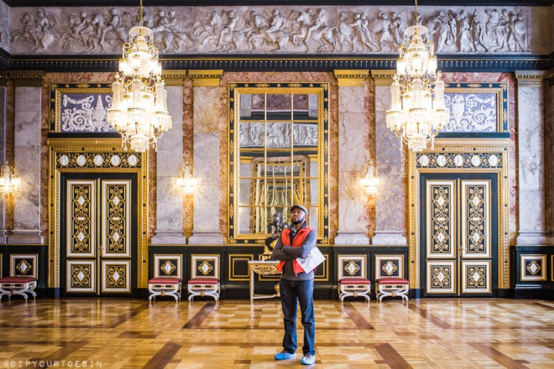 Man standing in grand room at Charlottenborg Palace | Visit Copenhagen