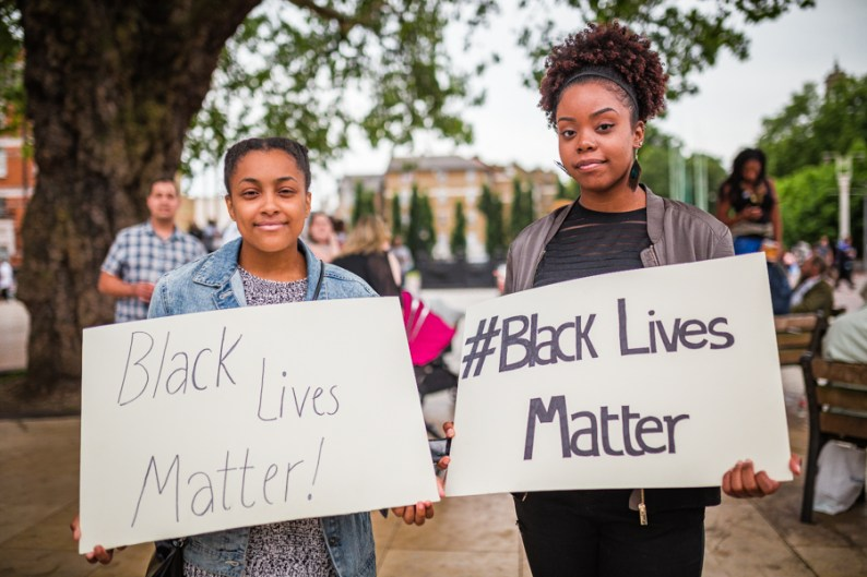 Young Women holding up Black Lives Matter signs at London Rally | Be An Ally to Black People