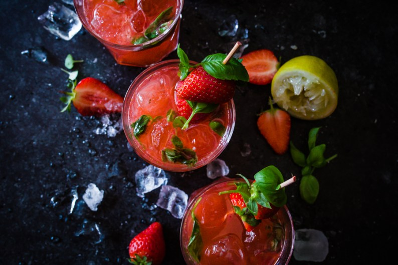 In this Mezcal and Tonic cocktail, add strawberries and basil for a fruity and herbal concoction