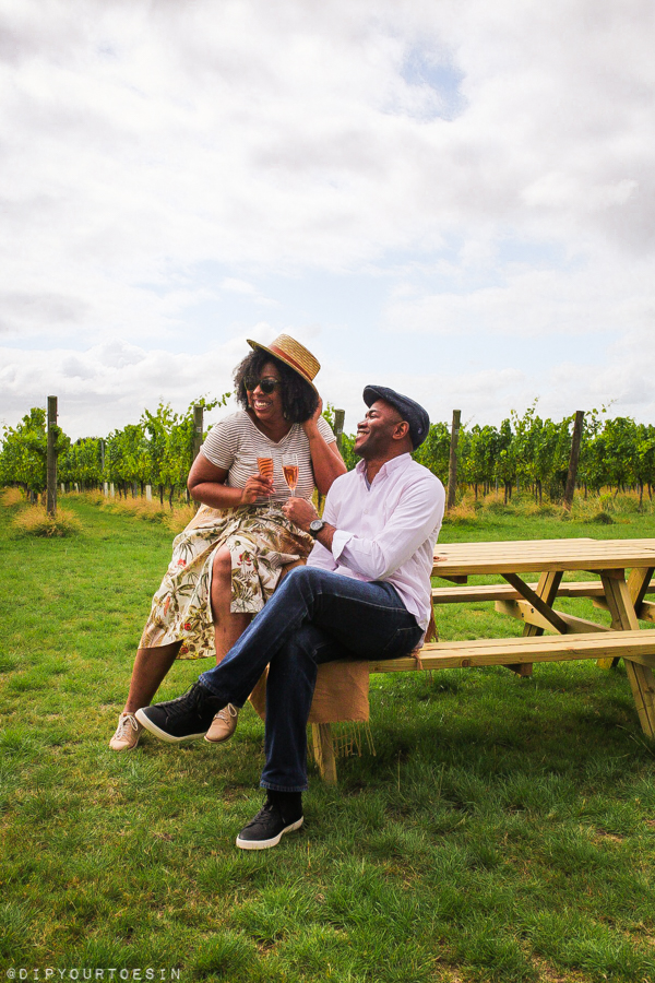 Couple enjoying wine at Woodchurch Wine Estate, Kent