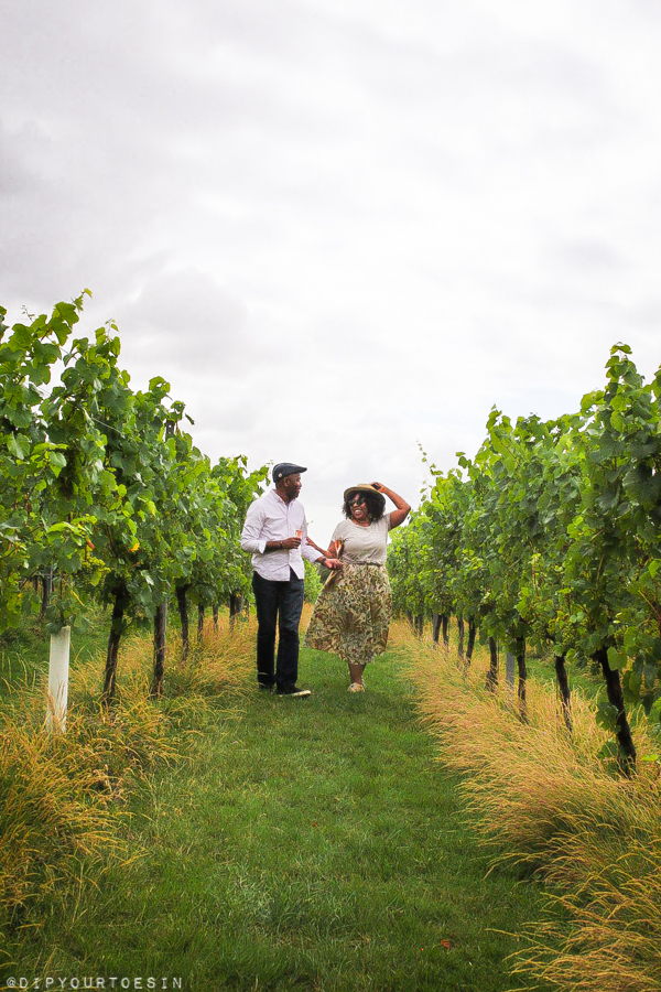 Couple walking in vineyard at Woodchurch Wine Estate, Kent