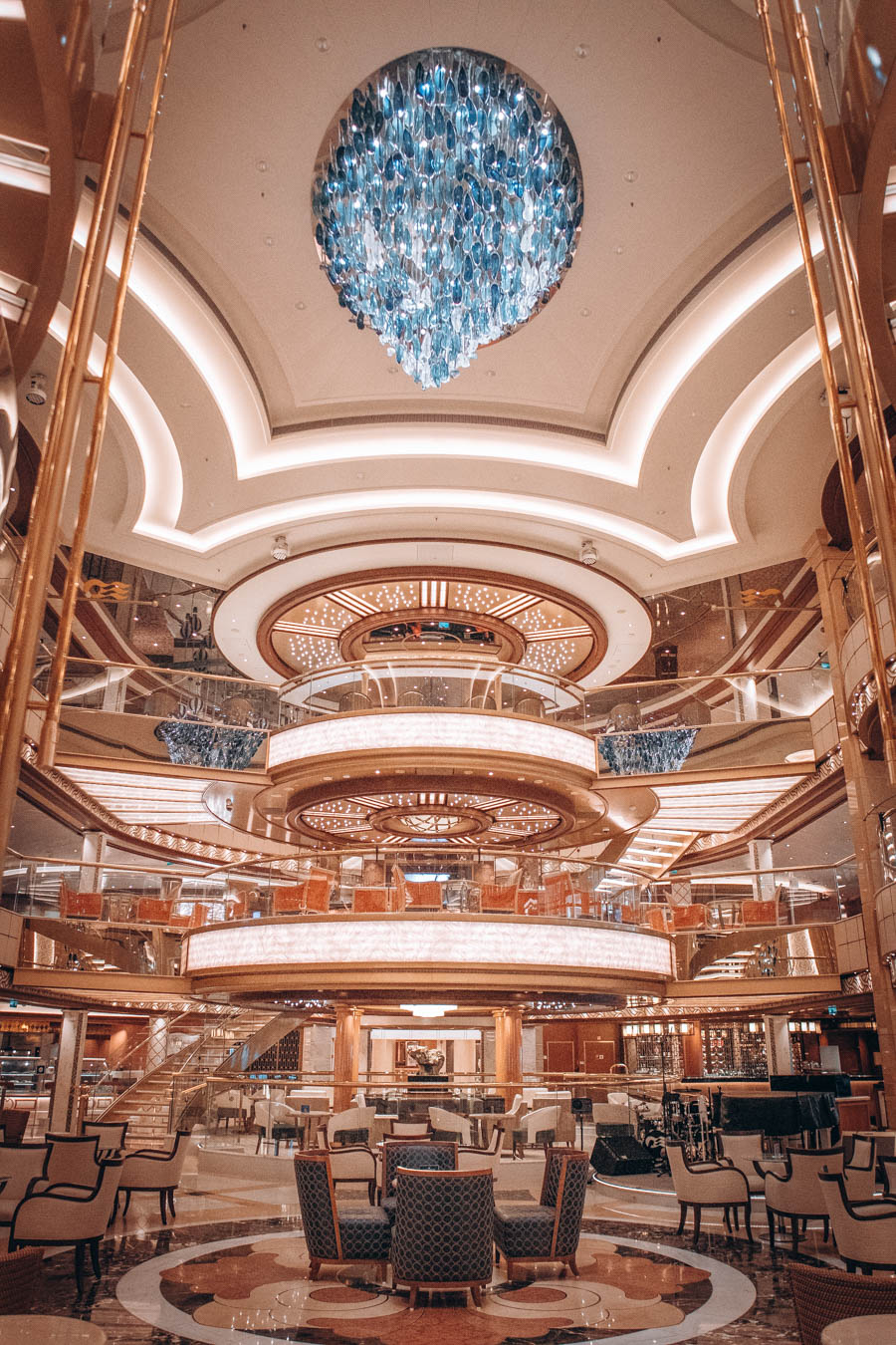 Portrait view of The Piazza showing chandelier   The main atrium of the Sky Princess   Princess Cruises