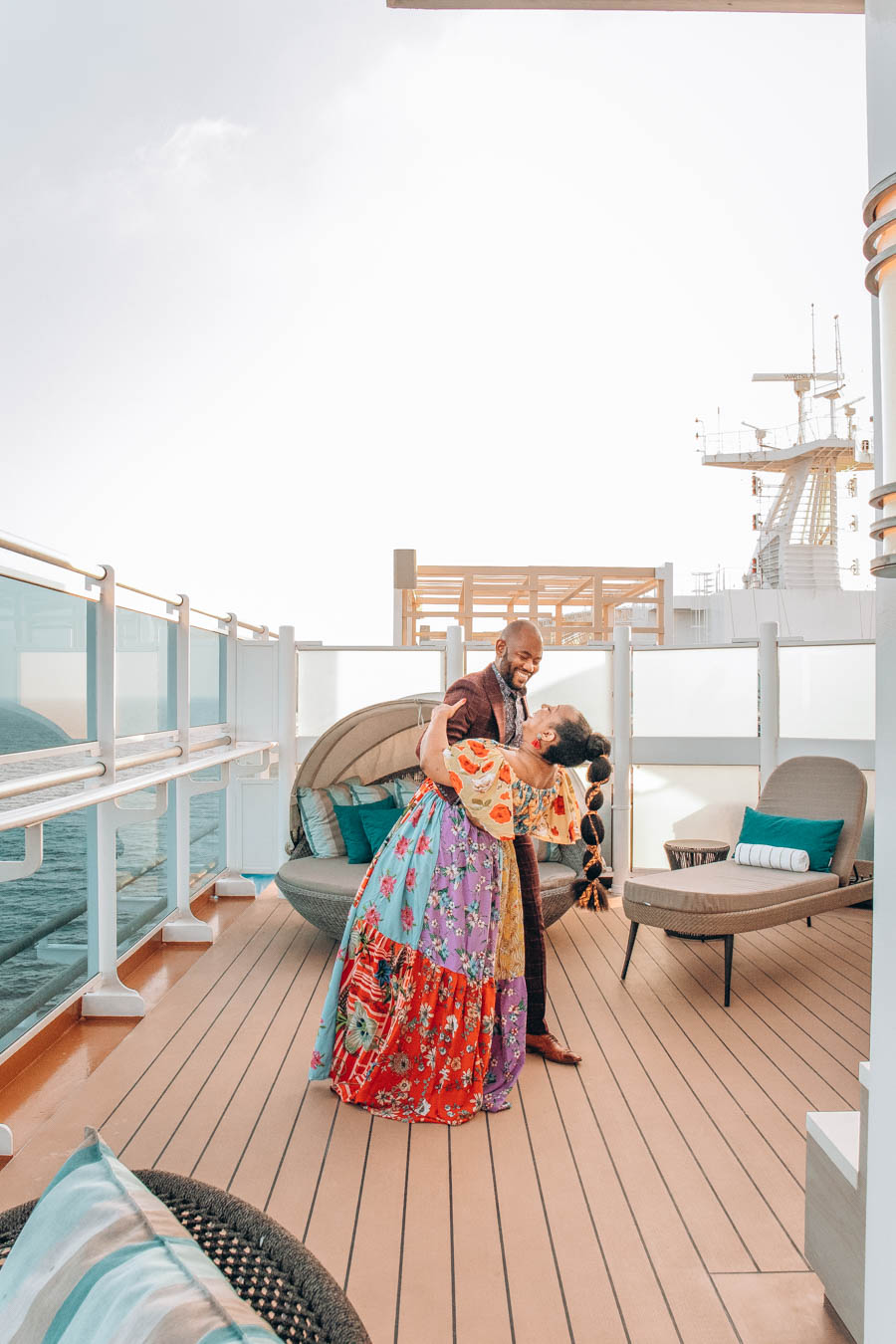 Omo and Eulanda in an embrace on the top deck of Sky Princess