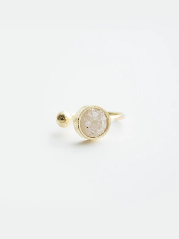 Bring a flicker of nature to your look with a druzy stone ring.