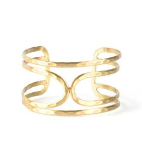 Ethically-sourced Brass Goddess Cuff design in white background.