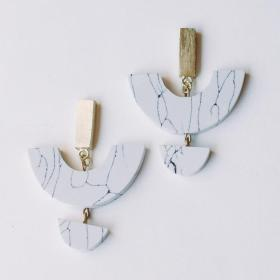 Flattering Marble Love Earrings made with brass and marble like design made of clay in white background.