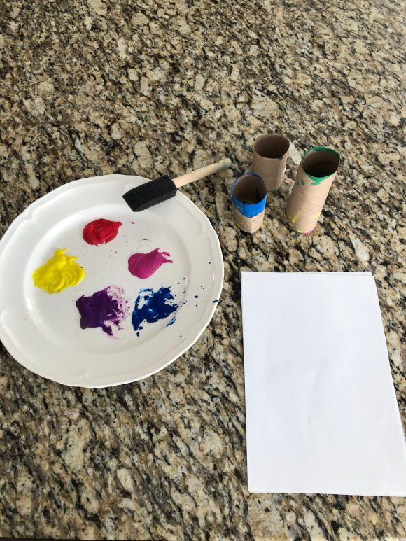 Supplies needed for spring painting with toilet paper rolls.