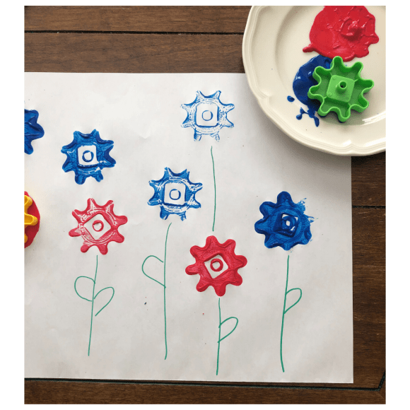 Gears used as stamps with washable paint make awesome flower paintings.