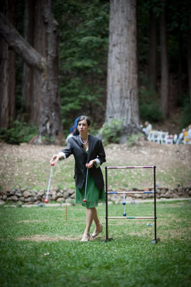 wedding guest playing ladder golf game