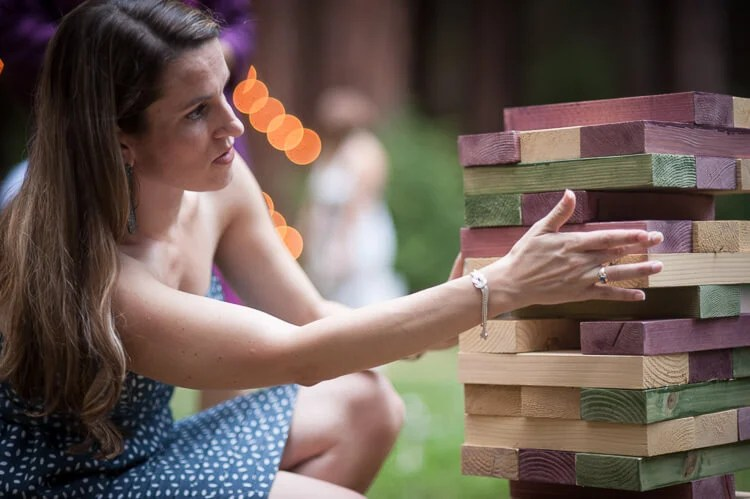 wedding guest playing lawn Jenga