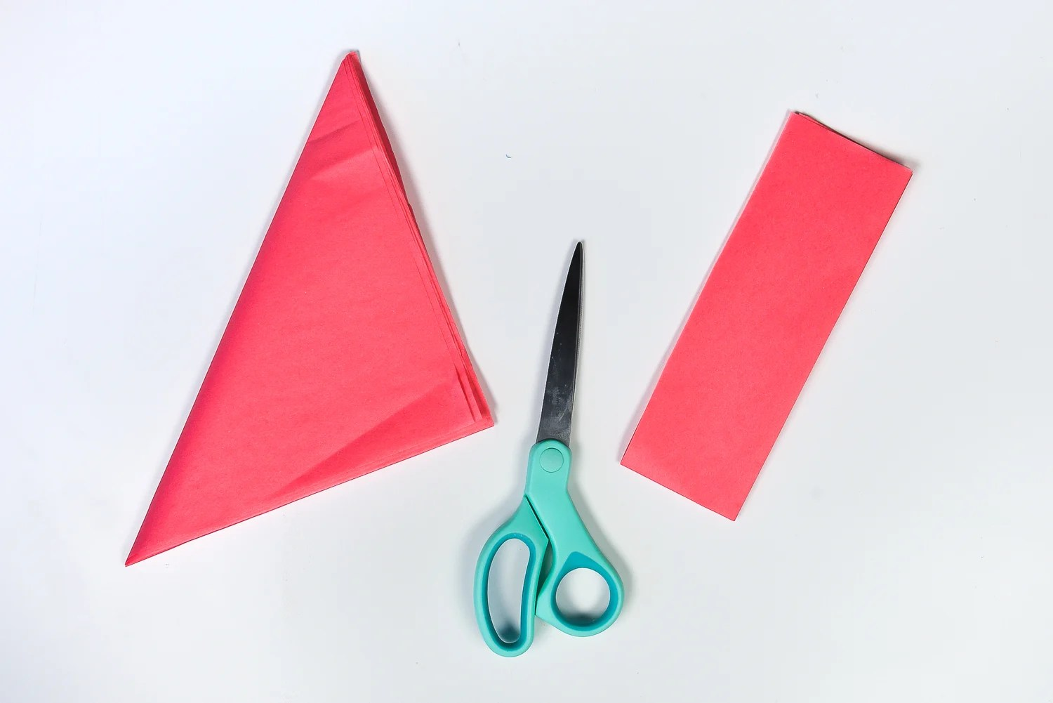 How to Make Tissue Paper Flowers: Cut off the extra part of the folded piece of tissue paper