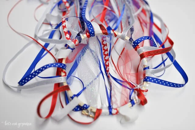 patriotic windsock tutorial - red, white, and blue ribbon attached to embroidery hoop