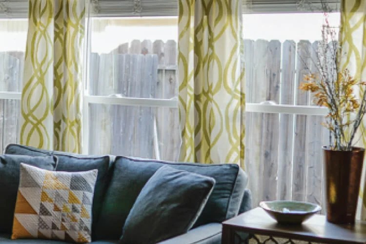 Hanging curtains doesn't have to be a pain! Learn how to hang them straight -- and keep the curtain rod from coming out of the wall!