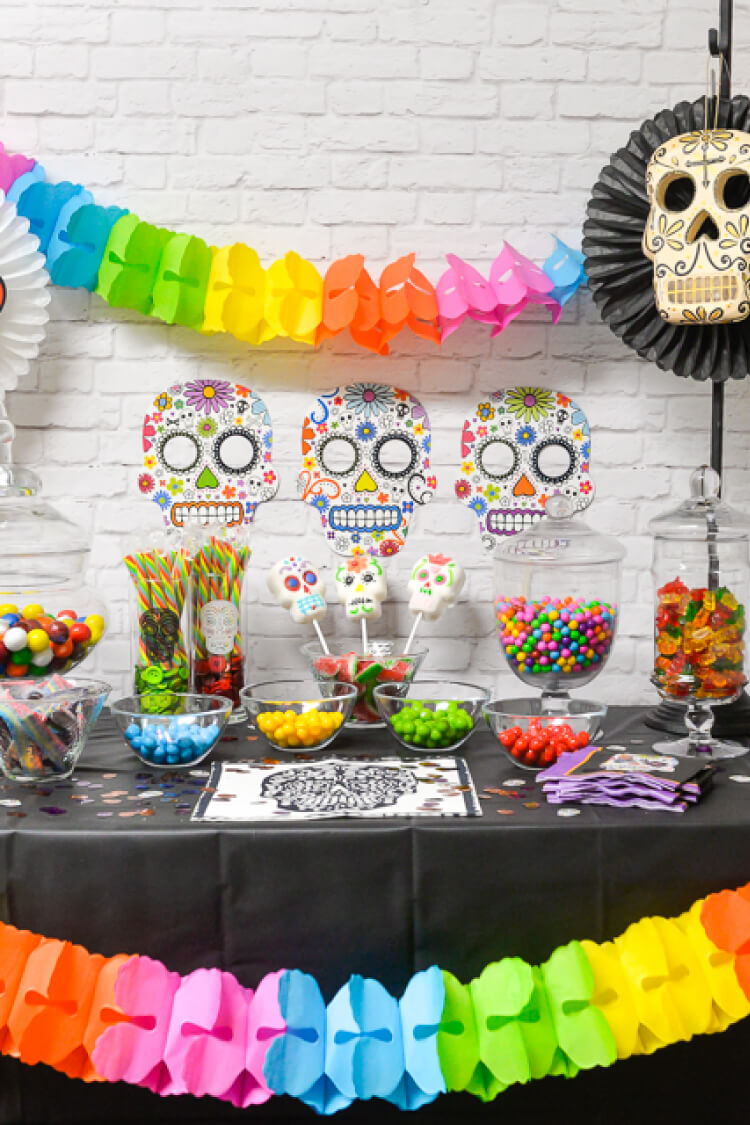 Take Sugar Skulls to a whole new level with this fun Dia de los Muertos Party Candy Bar! Halloween | Party | Candy