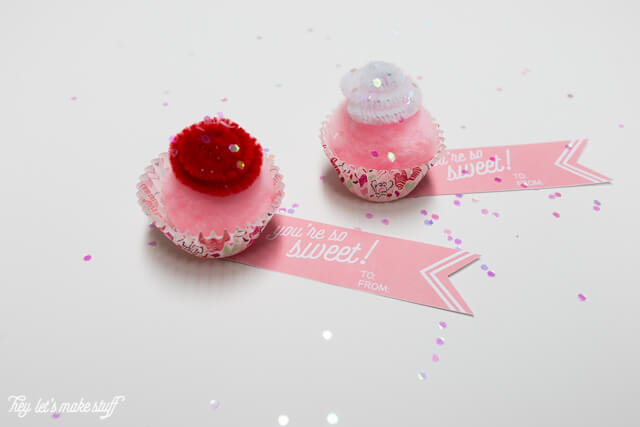 Puff balls and pipe cleaners make these adorable little valentines! Plus a free printable tag!