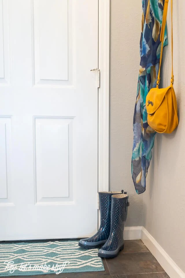 From dated country to modern and a little industrial, it's easy to make big changes even if you have a small entryway.