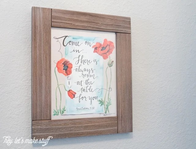 picture frame with wall art hanging from wall