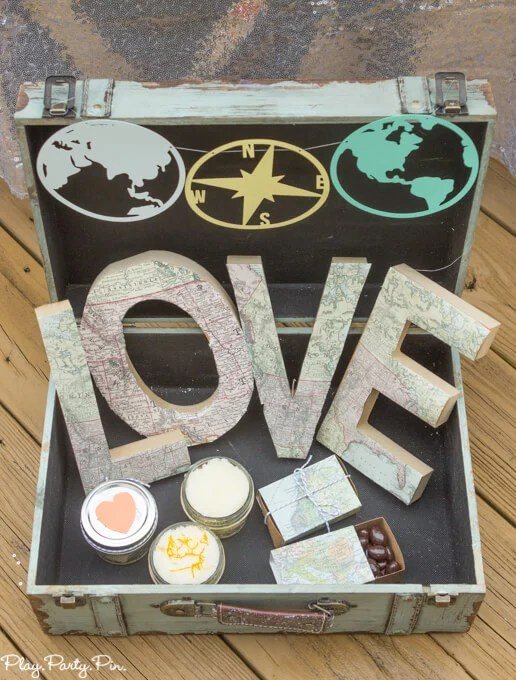 loves-makes-the-world-go-round-suitcase-top-1-of-1