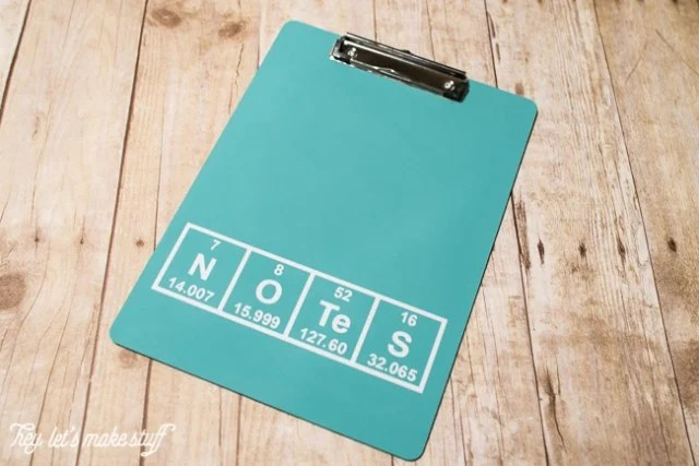 DIY periodic table clipboard on wooden background