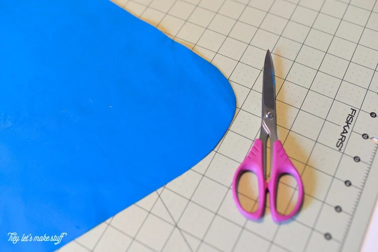 scissors and fabric for superman cape