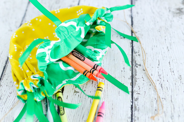 DIY cinched pineapple purse with crayons inside
