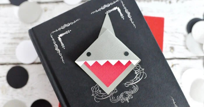 """Make these happy little """"shark mark"""" bookmarks! Great for celebrating Shark Week or for any time you're diving into a particularly delicious book."""