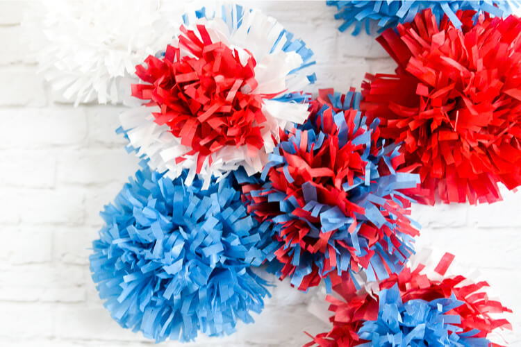 Red, white, and blue tissue paper explode in brilliant fireworks, perfect as easy Fourth of July party decor!