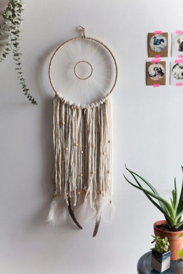 Monochromatic Dreamcatcher -- If you love the delicate, boho style of a dreamcatcher, here are 10+ dreamcatcher tutorials for you to try to make your own!