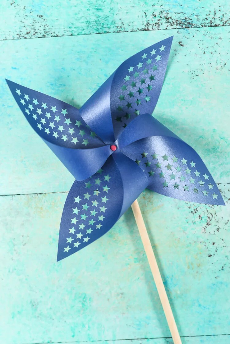 Blue Patriotic Pinwheel. Get the free SVG/DXF cut files for these decorative patriotic pinwheels! Delicate cut-outs made using your Cricut Explore make these star-spangled pinwheels a hit at any 4th of July party.