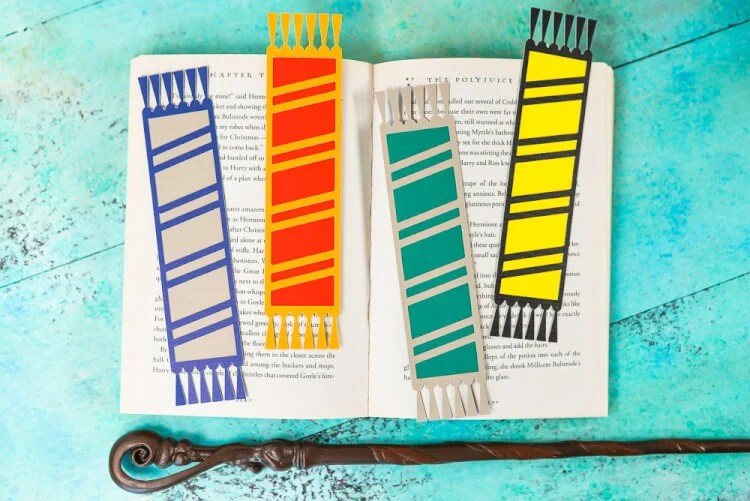All four bookmarks: Declare your Hogwarts House with these fun cut paper Hogwarts House bookmarks designed to look like Harry Potter and his friends' (and enemies'!) scarves! Free SVG download for the Cricut or Silhouette.
