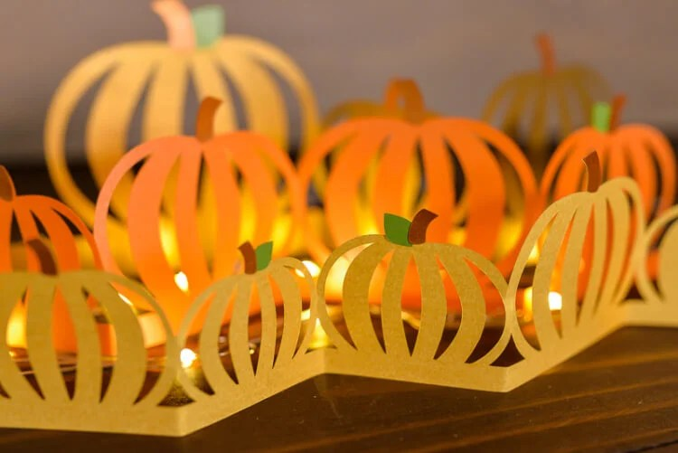 Looking for a fall decorating idea? Download the free SVG cut files for this gorgeous pumpkin luminaria! Cut the three layers on your electronic cutting machine and add twinkle lights, powered by RAYOVAC® batteries. #PoweredByRayovac #SureThing AD