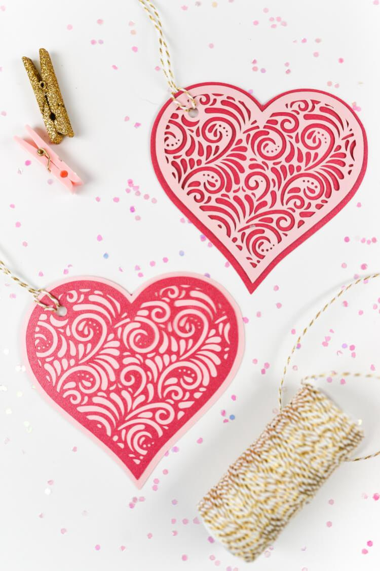 These intricate two-layer cut paper hearts, made on the Cricut or other cutting machine, are a beautiful addition to Valentine's Day gifts and Valentine's Day decor.