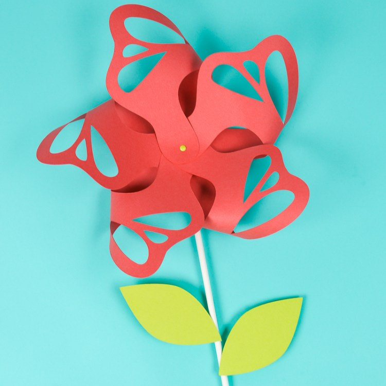 Flower paper pinwheels are beautiful for wedding and party decor, summer parties, and nursery decorations. Echoing butterflies and a little fancier than traditional pinwheels, they can easily be made using you Cricut or other cutting machine!