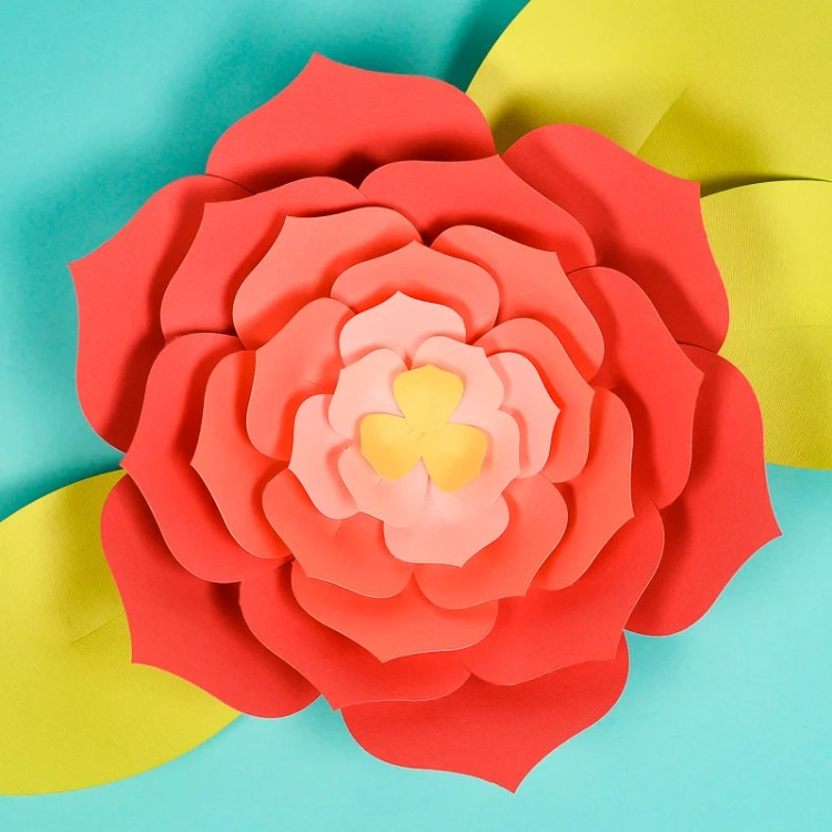 Download this giant paper flower template (hand cut or SVG for the Cricut) and then get my best tips and tricks for making them easily! Perfect for giant paper flower backdrops, beautiful home decor, and festive party decorations.